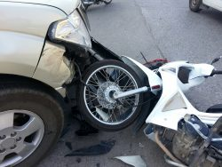 Accident between pickup truck and motorcycle